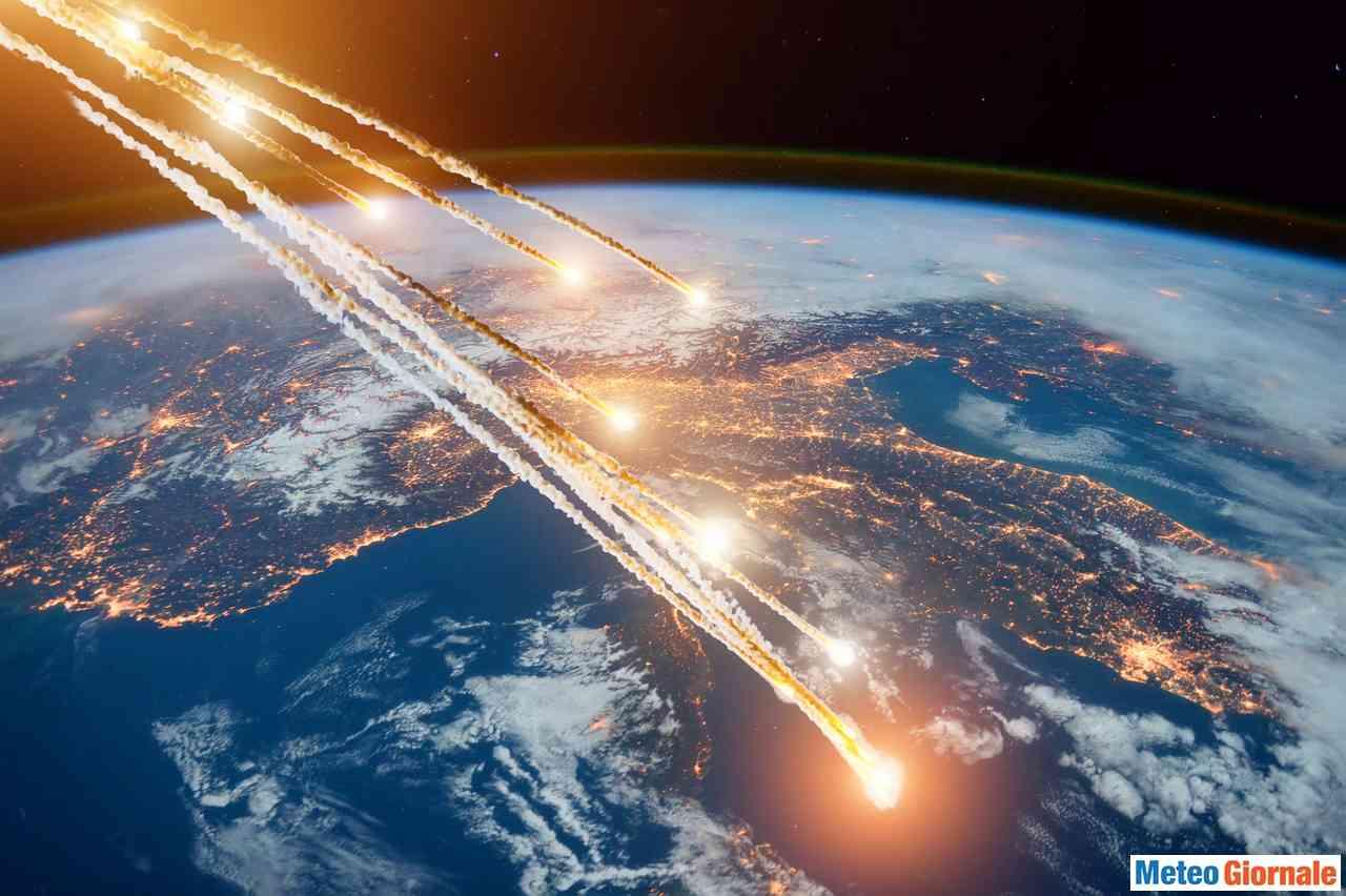Rappresentazione grafica di asteroidi in rotta verso la Terra. Nella foto si vede l'Italia. Credit foto AdobeStock,