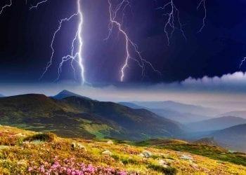 Thunderstorm with lightning in mountain landscape. Dramatic sky. Carpathian, Ukraine.