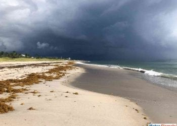 Storm rolling onto the beach with dark clouds and destruction